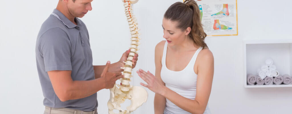 therapist explaining to patient